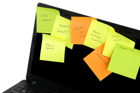 Laptop with a lot of tasks on sticky notes illustrating daily rush Stock Photo