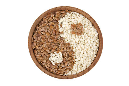organic flax seed: Sesame and flax seeds in form of Yin Yang symbol isolated on white