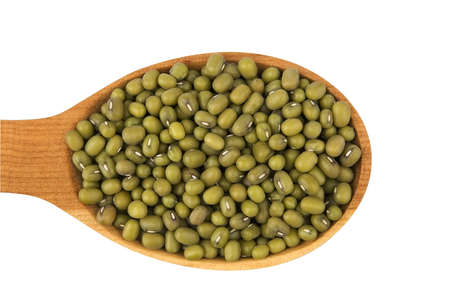 Raw mung beans in wooden spoon isolated on white photo