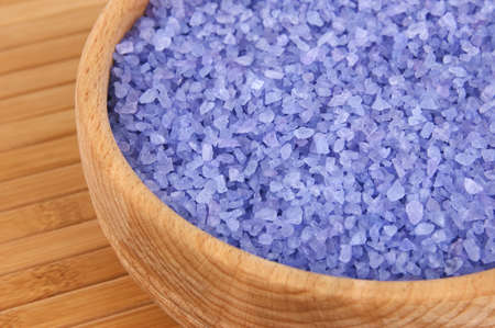 enriched: Sea salt enriched with lavender oil in wooden bowl close up Stock Photo