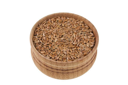 organic flax seed: Flax seeds in wooden bowl isolated on white
