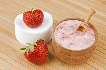 Homemade facial mask of strawberry and cream photo