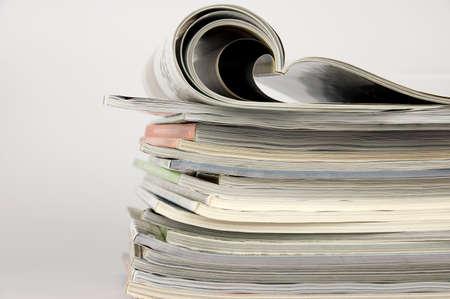magazine stack: Pile of magazines over white background Stock Photo