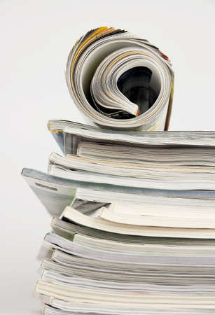 periodicals: Pile of magazines over white background Stock Photo