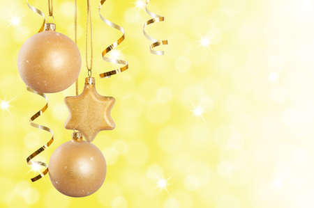 Golden Christmas decorations over sparkling background photo