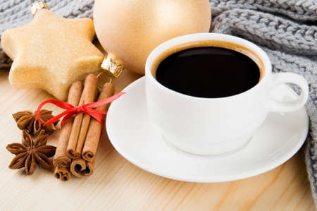 Cosy winter  Cup of coffee with scarf, spices and Christmas decorations Stock Photo - 22447290