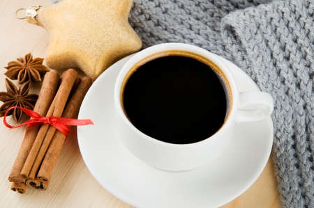 Cosy winter  Cup of coffee with scarf, spices and Christmas decoration Stock Photo - 22447291