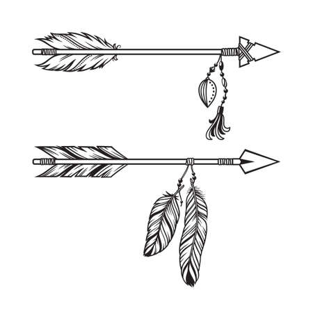 Tribal arrows with pendants of beads and feathers in ethnic, boho style