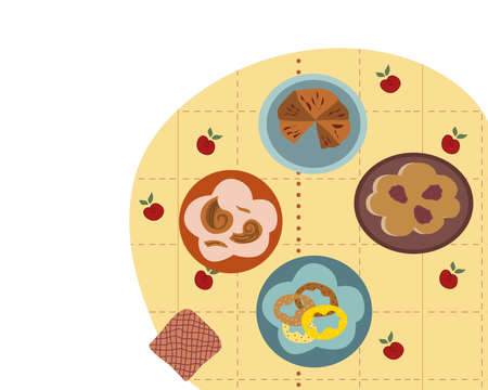 Treats on the table chocolate pie blackberry pie bagels donuts with sprinkles on plates tablecloth with apple pattern