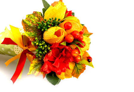 Paper flowers and berries for congratulations on the day of knowledge on a white background space for text