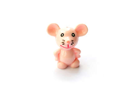 toy miniature pink mouse smiling isolated object on white background space for text