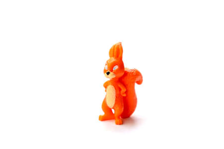 Isolated object toy made of plastic red squirrel stands on a white background space for text Stock fotó
