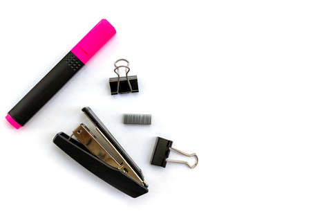 Isolated items stationery stapler staples clamps pink marker on white background top view space for text Stock fotó