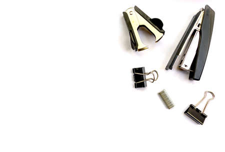 Isolated items stationery stapler staples clips on white background top view space for text Stock fotó