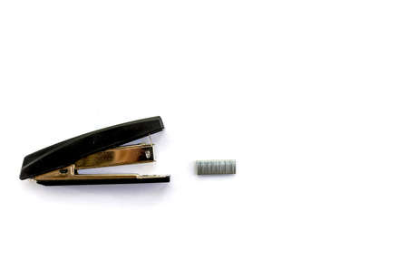 Isolated items for study and work in the office and at home stapler staples office top view on a white background space for text