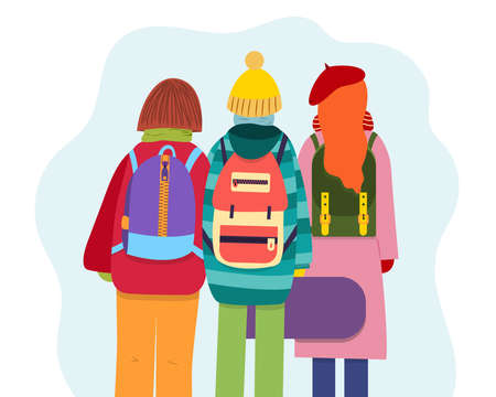 Young people with backpacks dressed in winter clothes