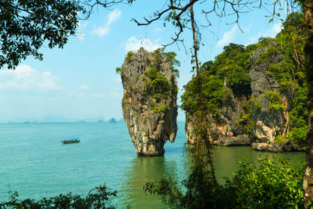 Famous Khao Ta-pu rock at the Khao Phing Kan at Phang Nga Bay National Park. The island is known as the James Bond Island from the movie