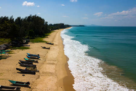 Aerial view of a long lonely beautiful beach in Natai, Ban Khok Kloi, Thailand, Asia. Natai beach with fishing boats and without people