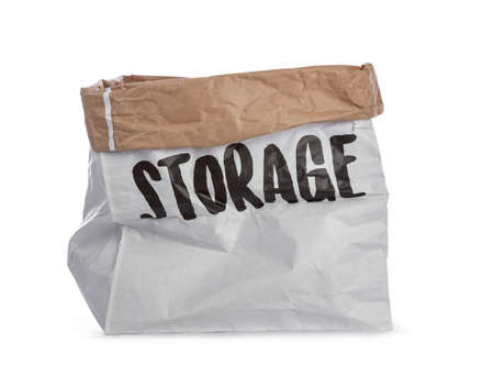 Empty big paper bag with storage written on the side. Isolated on a white background. Stockfoto