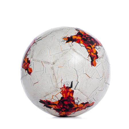 Close up studio shot of white with orange markings soccer ball, isolated on white background.