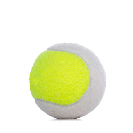 Close up studio shot of yellow and white tennis ball, isolated on white background.