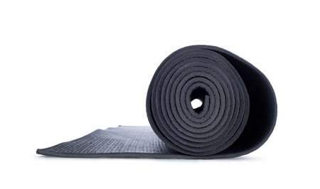 Close up studio shot of rolled op yoga mat, side view. Isolated on white background. Stock fotó