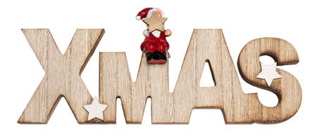 Wooden Xmas text Christmas decoration with little santa sitting on top. isolated on white background.