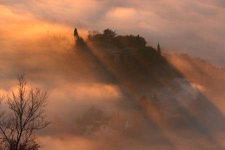 tilt views: landscape in the mist at sunset Stock Photo
