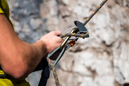 Close-up on the hands of a mountaineer belaying his climbing partner Standard-Bild