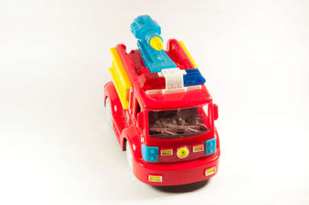 plactic: Toy fire truck on a white background