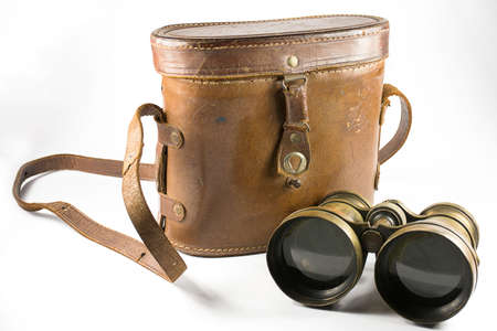 antique binoculars: binoculars And antique brown leather box on a white background . Stock Photo
