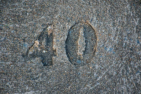 indentation: The 40 mark on the cement floor . Stock Photo
