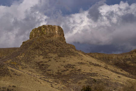 rock formation: Castle Rock, South Table Mountain in Golden, Colorado with Dramatic Sky with Clouds Stock Photo
