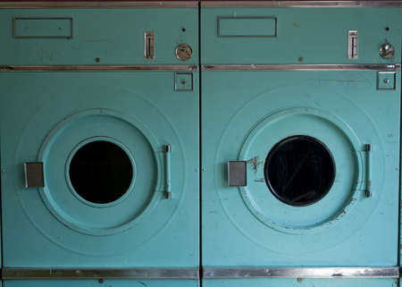 scratched: Two Turquoise-Colored Laudromat Dryers Worn and Scratched