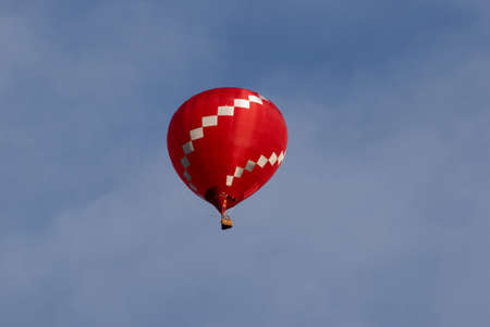 Red Hot Air Balloon Against Blue Sky