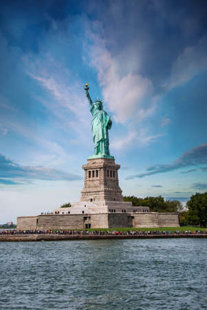 Statue of Liberty on Liberty Island with New York Harbor in Foreground