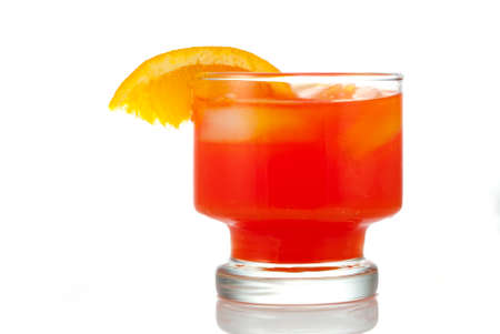quencher: Orange Beverage in glass with ice cubes and slice of orange on rim of glass