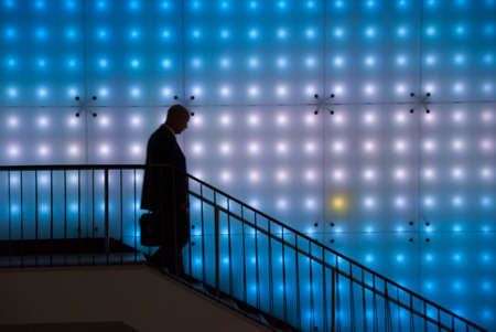 Silhouette of Man Walking Down Steps to Brussels Grand Centraal Metro 写真素材