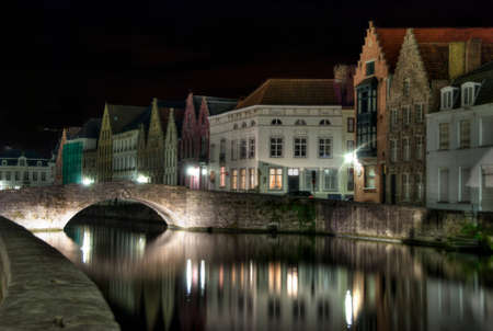 Long exposure taken at night along one of the picturesque canals in Bruges, Belgium  photo