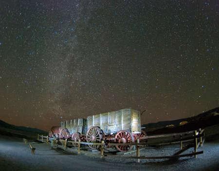 borax: Old Harmony Borax Works Wooden Wagon Under a Night Sky Stock Photo