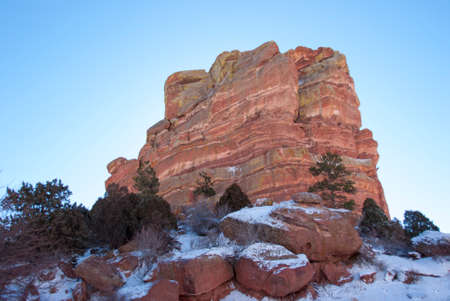 Monolith: Red Rock Sandstone Monolith with snow in Foreground Stock Photo