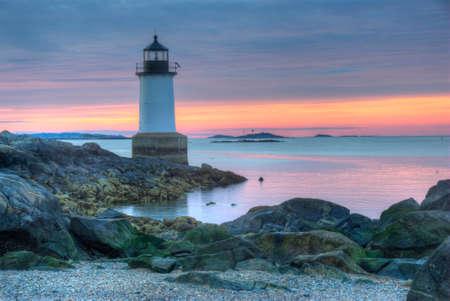 winter sunrise: Fort Pickering Lighthouse at sunrise, Salem, Massachusetts Stock Photo