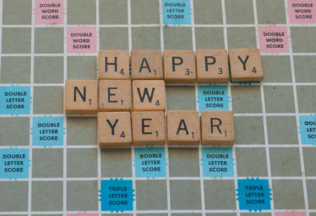 Happy New Year spelled out on Scrabble Board
