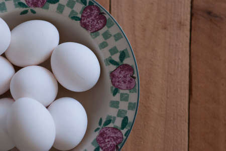 Fresh White Eggs in A Bowl on Wooden Table
