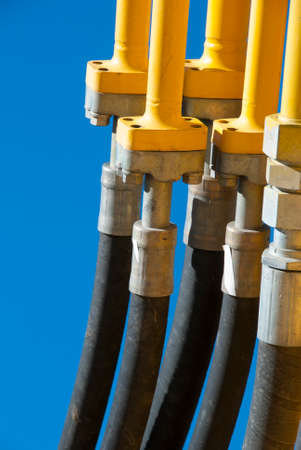 hoses: Vertical view of hydraulic hoses of an excavator machine