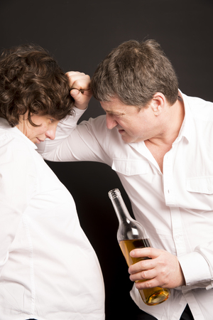 prevalence: Soon dad. senior violent father with his wife Stock Photo