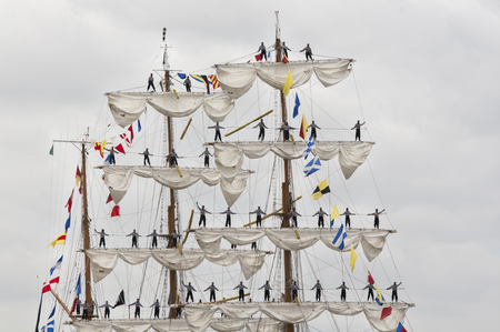 Few men standing up on the matt of sail boat, parade of Armada on the Seine, France Stock Photo