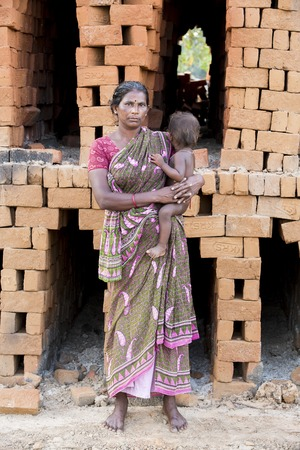 6 12: Asia India Tamil Nadu Sengal Soolai village June 2014 All people of the village work 12 hours a day 6 days per week doing hand made bricks for buildings and house.