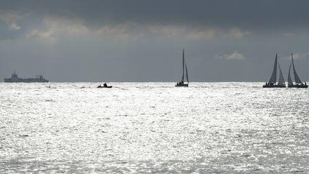 manche: sea ocean wave boat stones France Normandy Manche Stock Photo