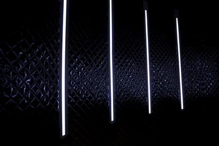 Neon tube light colored night disco black background